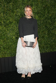 Dree Hemingway dolled up her top with a flouncy white maxi skirt, also by Chanel.