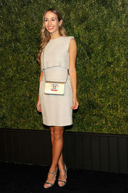 Harley Viera-Newton styled her dress with elegant silver evening sandals.