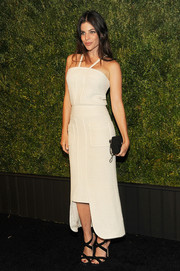 Julia Restoin-Roitfeld paired her dress with chic black crisscross-strap sandals.