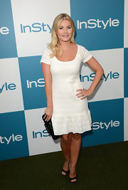 Elisha Cuthbert looked adorable in this white cap-sleeved day dress at the InStyle Summer Soiree.