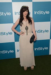Ashley had a dark bohemian-meets-Goth vibe in this nude pleated maxi-dress and statement accessories.