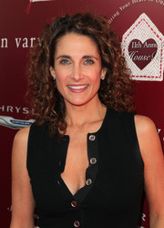 Melina Kanakaredes stuck to her trademark tight curls when she attended the John Varvatos Stuart House Benefit.