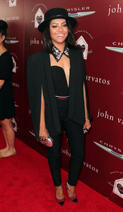 Kat Graham showed off her style chops in a black cape coat layered over a sexy jumpsuit during the John Varvatos Stuart House Benefit.
