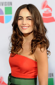 Camilla Belle showed off her long curls while attending the Latin Grammy Awards. She  finished off her look with a light application of lip gloss.