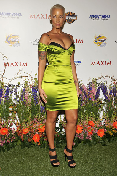 The curvy model wore a multi-strapped pair of black sandals with a skin-tight satin mini dress.