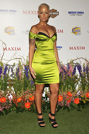 Amber Rose walked the carpet without superstar Kanye West in a lime green cocktail dress.