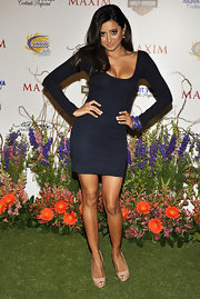 Noureen DeWulf stacked up three blue bangles to match her dark blue mini dress.