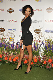 "The model rocked a body-hugging black mini dress with a pair of 5"" Pigalle pumps."