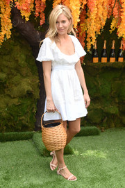 Sienna Miller paired her cute frock with pink block-heeled sandals by Mansur Gavriel.