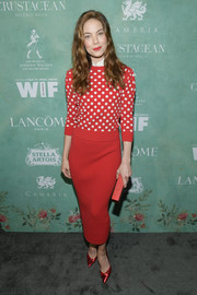 Michelle Monaghan complemented her top with a red knit pencil skirt, also by Michael Kors.