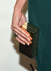 Izabel Goulart's gold box clutch at the Brazil Foundation NYC Gala was so elegant in its simplicity.