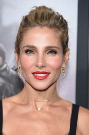 A pair of dangling diamond earrings provided a glamorous finish.