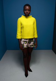 Lupita Nyong'o opted for a pair of printed short shorts, also by Honor, to complete her outfit.