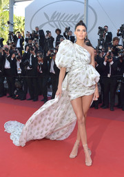 Kendall Jenner made an unforgettable entrance at the Cannes Film Festival screening of '120 Beats Per Minute' in a Giambattista Valli Couture one-shoulder dress boasting a long train and a voluminous sleeve.