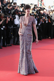 Paz Vega opted for a short-sleeve, deep-V print gown by Armani Prive when she attended the Cannes Film Festival screening of '120 Beats Per Minute.'
