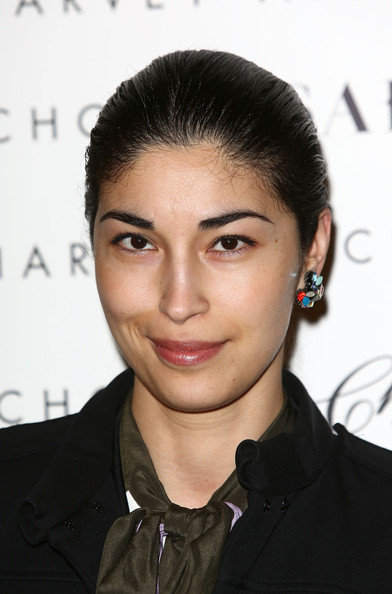 Caroline Issa swept her hair back into a simple updo for the launch of 1205 Paula Gerbase.