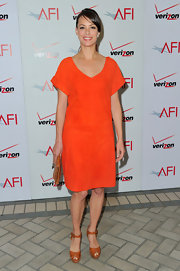 Berenice Bejo paired her vibrant orange dress with cognac platform sandals.