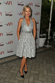 Penelope Ann Miller wore a silver brocade halter dress to the AFI Awards.