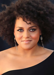 Marsha Ambrosius complemented her minimalist dress with an elegant pair of dangling gemstone earrings.
