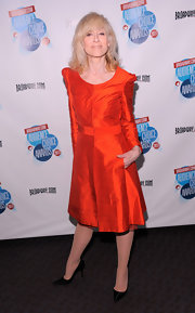 This gorgeous autumnal orange cocktail dress made Judith Light look radiant.