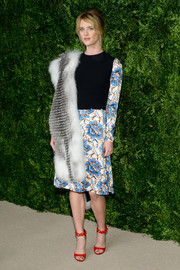 Mackenzie Davis attended the CFDA/Vogue Fashion Fund Awards looking retro in a long-sleeve floral dress by Creatures of the Wind.