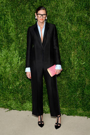 Jenna Lyons injected a pop of pastel with a pink envelope clutch.