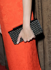 Nadja Swarovski added a dash a jewels to her sherbet orange dress with a black gemstone clutch. We love when celebs spice things up with embellishments.