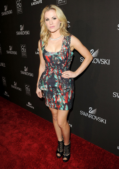 The stylish Anna Paquin posed to show off her cage ankle boots. Her black peep-toe boots were a clever way to spice up her feminine floral dress.