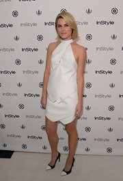 Rachael Taylor chose an ivory white halter neck dress with asymmetrical tiers.