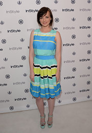 Ashley Rickards' colorful striped dress just screamed summer fun.