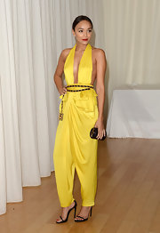 Ashley went for bold color with this canary yellow jumpsuit that featured cool baggy pants and draping at the waist.