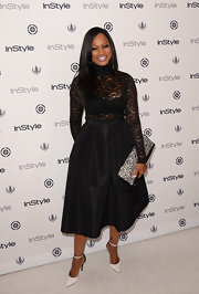 Garcelle added some retro flare to her look with this full black skirt.