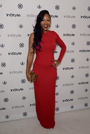 Meagan went bold with a long-sleeve one-shoulder dress at InStyle's Summer Soiree.