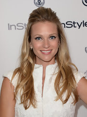 A.J. pulled back her wavy locks into a teased half updo for the InStyle Summer Soiree.