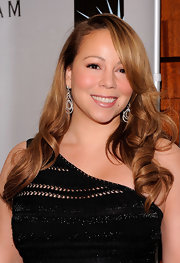 Mariah Carey's pale pink lips are slightly metallic for extra sheen.