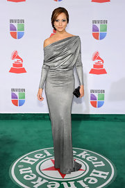 Satcha Pretto accented her sophisticated silver gown with a sleek black hard case clutch.
