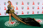 Dmanti certainly made a statement at the Latin Grammys in a theatrical gown with an endless train.