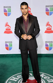 Wilmer Valderrama pulled off a bachelor-esque outfit featuring a satin collared blazer at the Gammys.