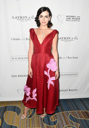 Camilla Belle went for ultra-feminine elegance in a floral-appliqued red gown by Carolina Herrera at the Los Angeles Ballet Gala.