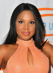 Toni Braxton arrived at the Orange Ball decked out in the vivid shade and wearing shimmering metallic copper eye shadow.