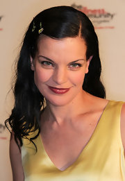Actress Pauley Perrette showed off her funky side at a Beverly Hills event. She donned embellished hairpins to jazz up her shoulder length locks.
