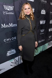 Maria Bello teamed a gray Urban Zen turtleneck dress with a gold body chain for the Women in Film Oscar nominees party.
