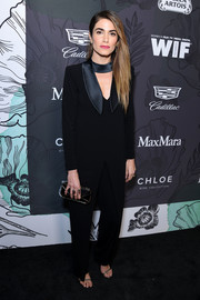 Nikki Reed kept it simple in a long-sleeve jumpsuit with choker detail at the Women in Film Oscar nominees party.