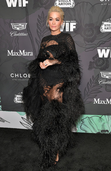 Rita Ora was a standout in a feathered lace gown by Jaime Major at the Women in Film Oscar nominees party.