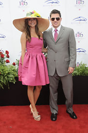 "Vanessa completed her sweet pink ensemble with a pair of bow-embellished, peep-toe, ""Raffia and Suede"" platform pumps."