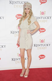 Marisa Miller looks like a southern belle in a nude draped cocktail dress and darling hat for the Kentucky Derby.