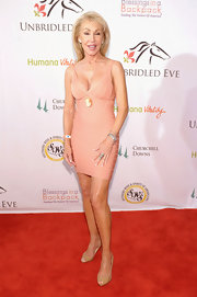 Linda Thompson went for a daring look with this super-sexy blush-colored bandage dress at the Kentucky Derby Unbridled Eve Gala.