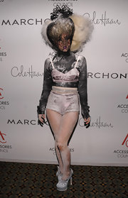 Lady Gaga matched her bizarre Marc Jacobs ensemble with a pair of John Galliano platform pumps (she'd tucked in the ankle straps).
