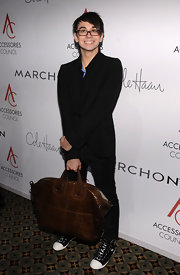 Christian showed off his patent leather tote bag while attending the ACE Awards.