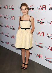 Kiernan looked lovely in a pastel yellow frock that featured delicate black piping and a belt.
